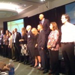Dr. M accepts wellness award on behalf of McKinley Chiro!
